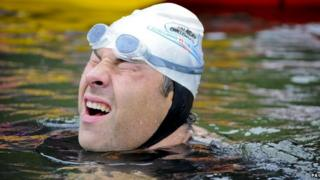 David Walliams wincing during his Sport Relief challenge to swim 140 miles along the River Thames