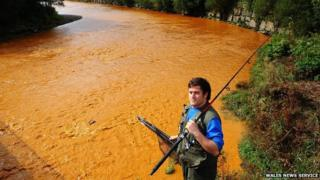 River Neath turns orange