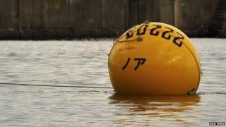 Yellow flotation pod in the water