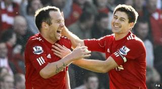 Charlie Adam and Steven Gerrard celebrate a goal against Manchester United