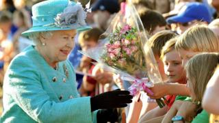 Queen given flowers by children