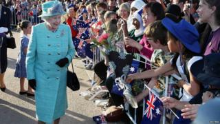 Queen greeting crowds