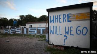 "Graffiti saying ""where will we go?"" and ""resist"""