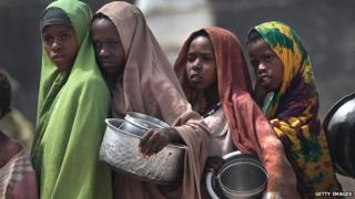 Girls in Somalia refugee camp queue for food aid