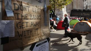 Poster saying 'don't let the banks get away with it' outside st paul's cathedral