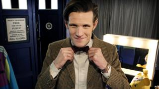 Matt Smith as Doctor Who adjusting his bowtie