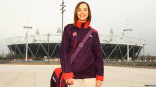 Helen, a Games Maker volunteer, models the new uniform outside the Stratford Olympic Stadium.