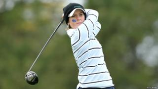 Lauren Taylor playing golf