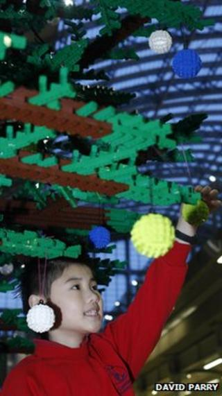 Child with Lego Christmas tree