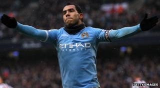 Carlos Tevez with arms outstretched