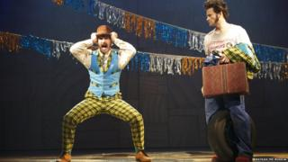 Two male actors performing a slapstick routine
