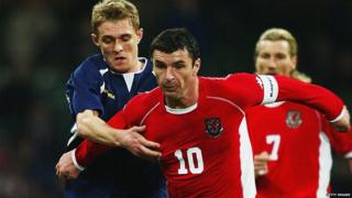 Gary Speed playing for Wales against Scotland