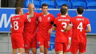 Welsh players celebrate scoring against Norway