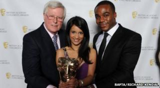Sonali, Ore and Newsround's first presenter John Craven pose with our special Bafta