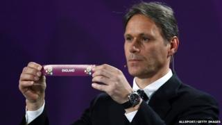 Marco van Basten from the Netherlands holds up England's slip during the Euro 2012 draw