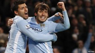 Manchester City's David Silva (R) celebrates with Sergio Aguero after scoring against Arsenal