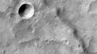 New crater and a wrinkle ridge on Mars