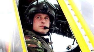 Prince William sitting in RAF helicopter