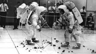 Astronauts practice collecting rock samples at the Kennedy Space Centre, 13 Oct 1969