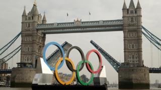 Tower Bridge raised to allow the Olympic rings through.
