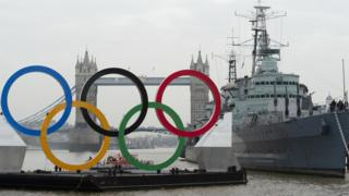 Olympic rings in front of Tower Bridge and HMS Belfast.
