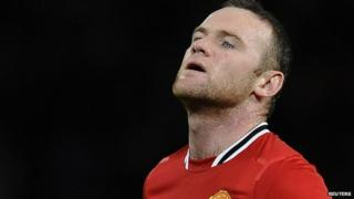 Wayne Rooney looks dismayed on the football pitch