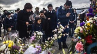 A family in Japan pay their respects to victims of the last years tsunami at a memorial