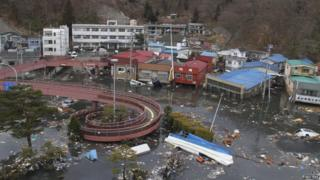 Streets flooded after the tsunami had struck - an area in Miyako, northeastern Japan in 2011