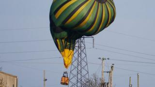 A hot air balloon stuck gets stuck in power lines in Northamptonshire.