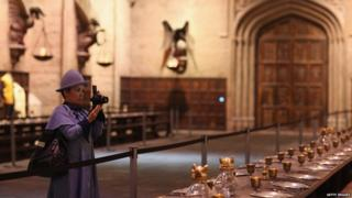 A visitor takes a picture of the Great Hall.
