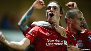 Andy Carroll celebrating with Martin Skrtel