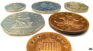 array of UK coins including 1p, 2p, 50p