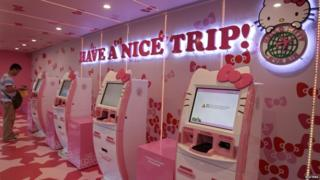 Pink self check-in counters at the airport terminal in Taiwan