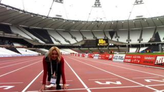 Hayley Cutts crouches on the running track at the new Olympic Stadium in east London