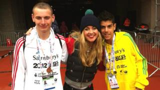 Hayley with two long jump athletes