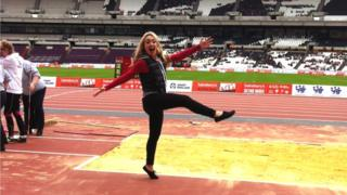 Hayley Cutts balances on the edge of the long jump pit