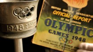 The London 1948 Olympic torch and programme which will go under the hammer during the Olympic Games.