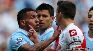 Carlos Tevez clashes with Joey Barton
