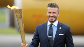 David Beckham with the flame during the ceremony to mark the arrival of the Olympic flame