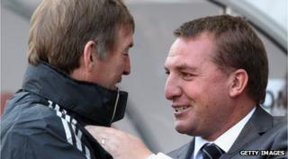 Kenny Dalglish chatting with Brendan Rodgers