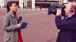 Leah reporting outside of Buckingham Palace