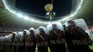 Riot police inside the stadium for Poland v Russia Euro 2012 match