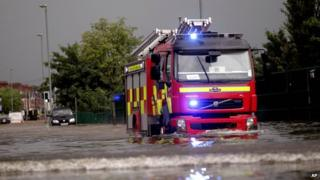Fire engine driving through floodwater