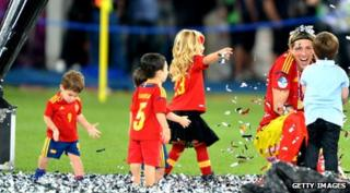 Torres chatting with children wearing Spain football kit