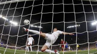 John Terry clears the ball away from his goal during the Euro 2012 soccer championship Group D match between England and Ukraine.