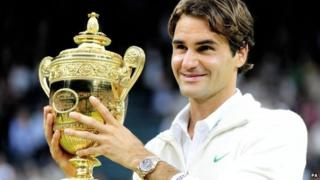 Roger Federer with Wimbledon trophy