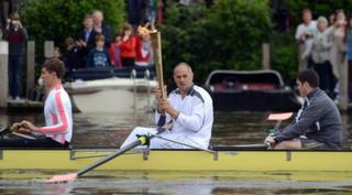 Sir Steve Redgrave carries Olympic flame.