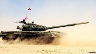 A handout picture released by the official Syrian Arab News Agency on July 8 2012, shows a Syrian army tank during military manoeuvres at an undisclosed location.