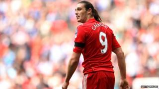 Andy Carroll wearing the Liverpool number 9 shirt.