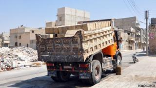 A truck loaded with boxes labelled gasmasks in Arabic is parked outside a rebel forces base in the northern city of Aleppo.